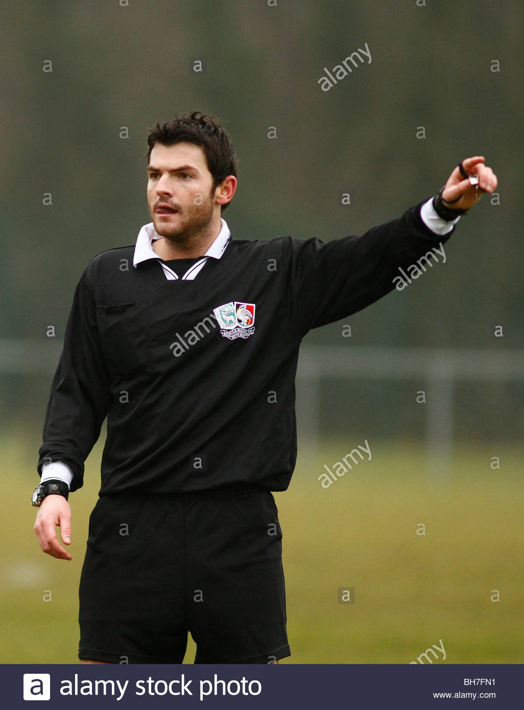 Name:  a-football-referee-points-after-awarding-a-decision-BH7FN1.jpg Views: 17 Size:  118.2 KB